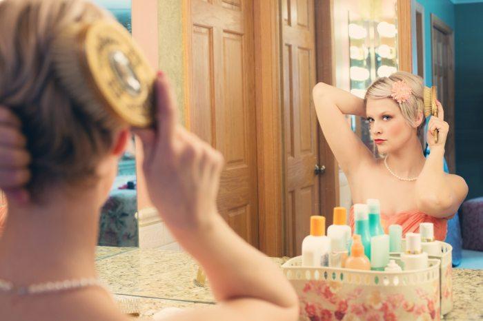 beauty-blonde-brushing-hair-39250